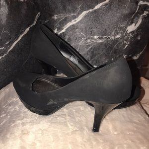 One pair of black stiletto heels